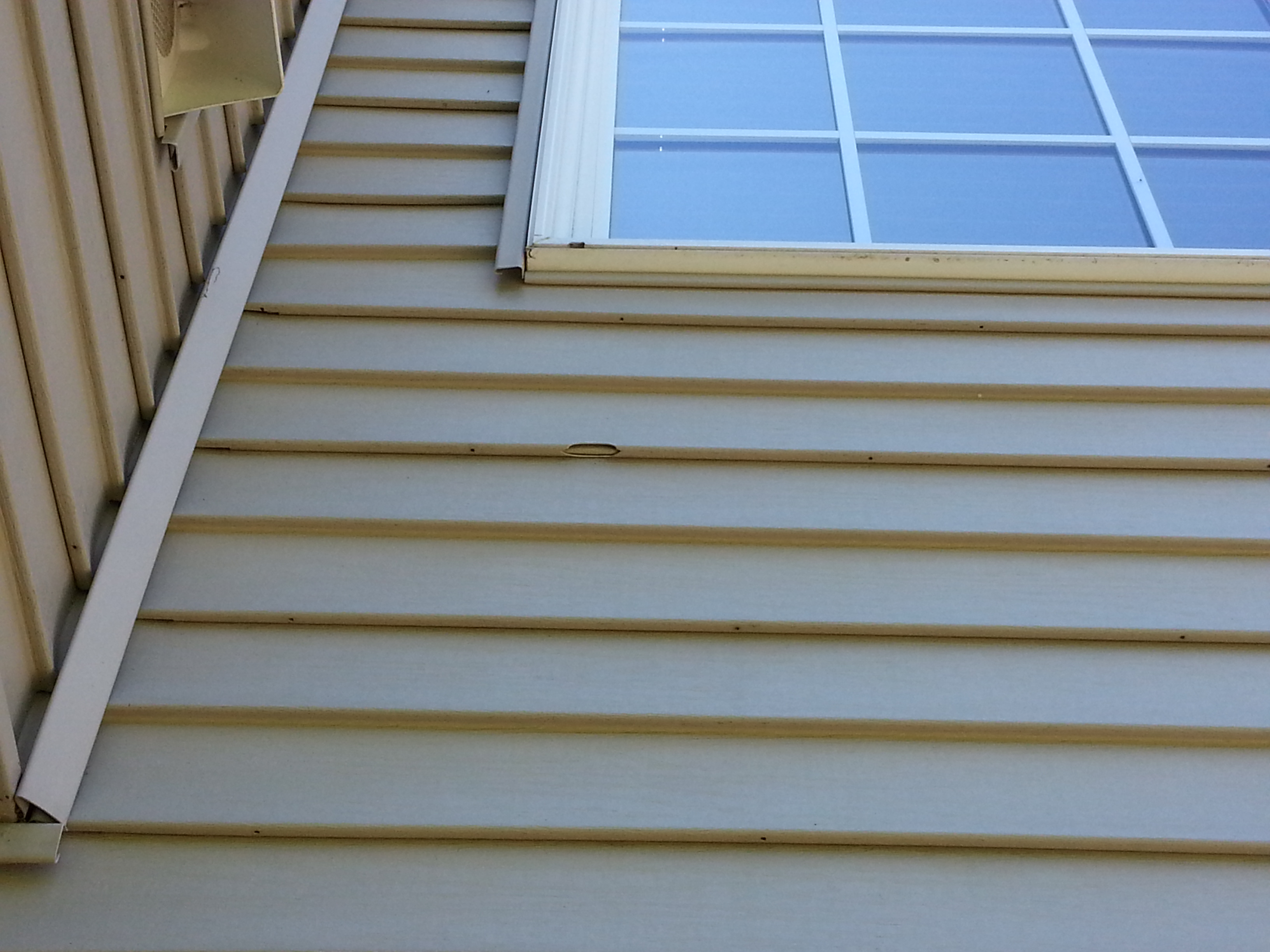 Hail damage repair roofing siding repair in mchenry county for Hail damage vinyl siding